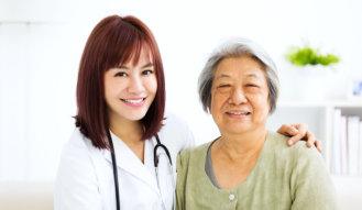 nurse and senior woman are smiling