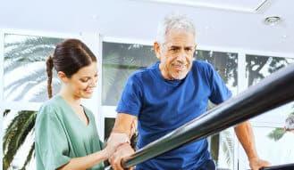 caregiver assisting senior man having a therapy