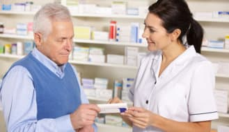 senior man consulting to the female pharmacist regarding to the medicine at the pharmacy