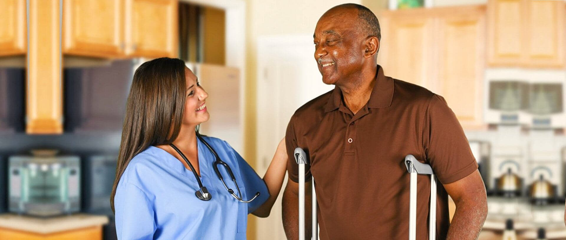 nurse and senior man are smiling