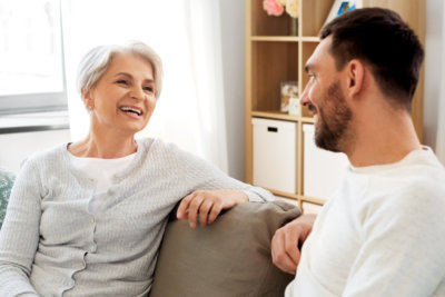senior woman and male therapist having a conversation