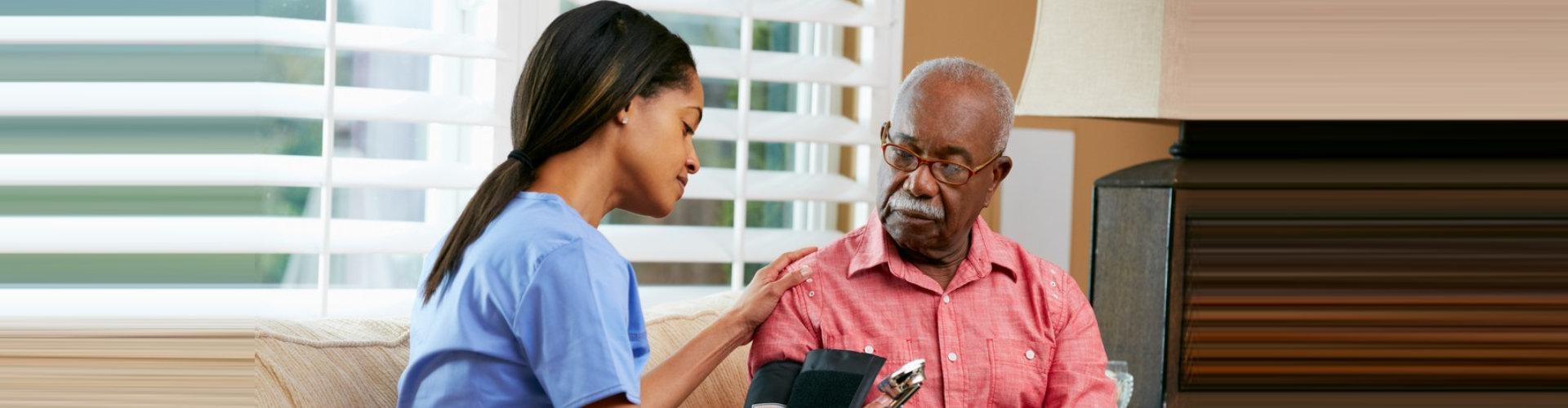 nurse monitoring the health condition of senior man