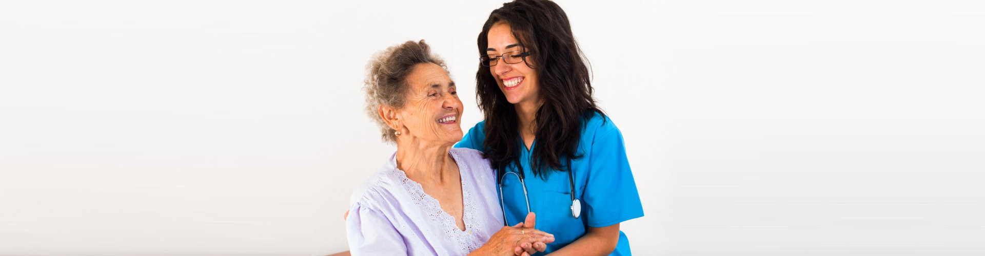 nurse and senior woman are smiling
